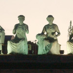 Green Goddess Statues (lighted) on rooftop of River Plaza Building