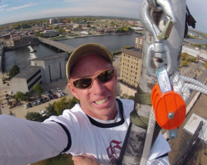 Ty Graham takes a photo of himself high above downtown Waterloo.